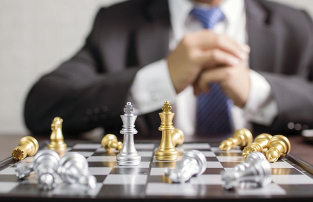 businessman planning to move chess